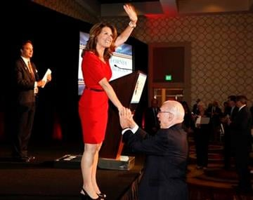 Republican presidential candidate Rep. Michele Bachmann, R-Minn., greets a supporter after the California Republican Party Fall Convention dinner in Los Angeles, Friday, Sept. 16, 2011. (AP Photo/Chris Carlson) By Chris Carlson