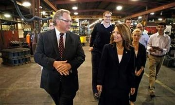 Republican presidential hopeful Rep. Michele Bachmann, R-Minn., walks with Charles Sukup, left, during a plant tour at Sukup Manufacturing, Monday, Sept. 19, 2011, in Sheffield. (AP Photo/Charlie Neibergall) By Charlie Neibergall
