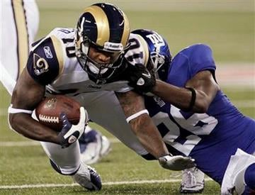 St. Louis Rams wide receiver Mike Sims-Walker (10) is tackled by New York Giants free safety Antrel Rolle (26) during the second quarter of an NFL football game Monday, Sept. 19, 2011, in East Rutherford, N.J. (AP Photo/Julio Cortez) By Julio Cortez