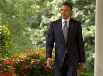 President Barack Obama walks from the Oval Office to the the Rose Garden of the White House in Washington, Monday, Sept. 19, 2011, to talk about deficit reduction.  (AP Photo/Evan Vucci) By Evan Vucci