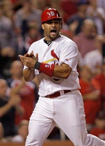 St. Louis Cardinals' Albert Pujols celebrates as he scores from second on a single by Lance Berkman in the fifth inning of a baseball game against the New York Mets, Tuesday, Sept. 20, 2011 in St. Louis.(AP Photo/Tom Gannam) By Tom Gannam