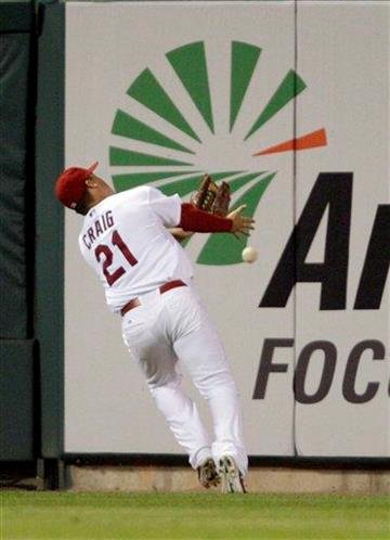 St. Louis Cardinals left fielder Allen Craig (21) can't make the catch on a ball hit by New York Mets' pitcher pitcher Mike Pelfrey in the fifth inning of a baseball game, Tuesday, Sept. 20, 2011 in St. Louis.(AP Photo/Tom Gannam) By Tom Gannam