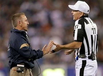 St. Louis Rams coach Steve Spagnuolo talks with referee Terry McAulay (77) during the first quarter of the Rams' NFL football game against the New York Giants on Monday, Sept. 19, 2011, in East Rutherford, N.J. (AP Photo/Julio Cortez) By Julio Cortez