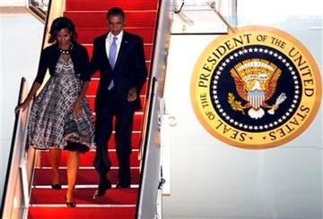 President Barack Obama and first lady Michelle Obama walk down the stairs from Air Force One upon arrival at Andrews Air Force Base, Md., Wednesday, Sept. 21, 2011.(AP Photo/Jose Luis Magana) By Jose Luis Magana