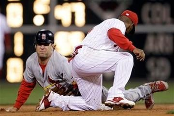 St. Louis Cardinals' Lance Berkman, left, steals second base past the tag from Philadelphia Phillies shortstop Jimmy Rollins during the second inning of a baseball game, Saturday, Sept. 17, 2011, in Philadelphia. (AP Photo/Matt Slocum) By Matt Slocum