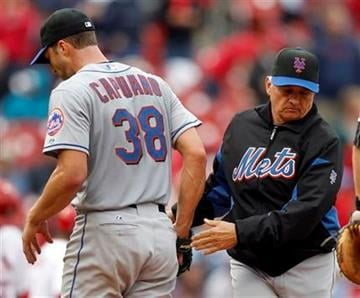 New York Mets starting pitcher Chris Capuano, left, is removed from the baseball game by manager Terry Collins during the fifth inning against the St. Louis Cardinals on Thursday, Sept. 22, 2011, in St. Louis. (AP Photo/Jeff Roberson) By Jeff Roberson