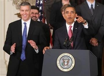 President Barack Obama stands with Education Secretary Arne Duncan as he speaks about No Child Left Behind Reform, Friday, Sept. 23, 2011, in the East Room of the White House in Washington. (AP Photo/Charles Dharapak) By Charles Dharapak