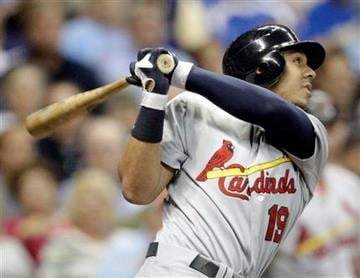 St. Louis Cardinals' Jon Jay hits a sacrifice fly during the fifth inning of a baseball game against the Milwaukee Brewers Tuesday, Aug. 30, 2011, in Milwaukee. Rafael Furcal scored from third. (AP Photo/Morry Gash) By Morry Gash