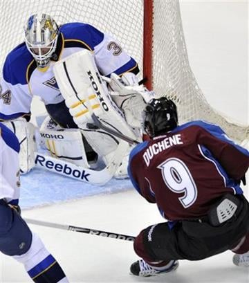 St. Louis Blues goalie Jake Allen (34) makes a save against Colorado Avalanche center Matt Duchene (9) during the second period of a preseason hockey game on Friday, Sept. 23, 2011, in Denver. (AP Photo/Jack Dempsey) By JACK DEMPSEY