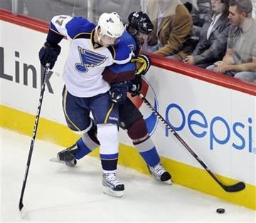 St. Louis Blues center Vladimir Sobotka (17) and Colorado Avalanche center Greg Mauldin, from the Czech Republic, tangle during the second period of a preseason hockey game on Friday, Sept. 23, 2011, in Denver. (AP Photo/Jack Dempsey) By JACK DEMPSEY