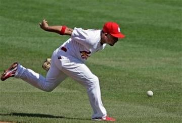St. Louis Cardinals shortstop Rafael Furcal can't get to a ball hit by Chicago Cubs' Darwin Barney in the first inning of a baseball game, Saturday, Sept. 24, 2011, in St. Louis. (AP Photo/Tom Gannam) By Tom Gannam