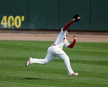 St. Louis Cardinals center fielder Jon Jay makes the catch on a ball hit by Chicago Cubs' Blake DeWitt in the first inning of a baseball game, Saturday, Sept. 24, 2011, in St. Louis. (AP Photo/Tom Gannam) By Tom Gannam