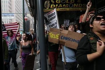 Participants in a march organized by Occupy Wall Street make their up Broadway Saturday Sept. 24, 2011 in New York.  Marchers represented various causes both political and economic. (AP Photo/Tina Fineberg) By Tina Fineberg