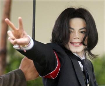 File-In this Feb.,2005 file photo showing Michael Jackson arriving for the first day of his child molestation trial at the Santa Barbara County Superior Court  in Santa Maria, Calif. (AP Photo/Michael A. Mariant,File) By MICHAEL A. MARIANT