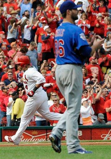 Chicago Cubs starting pitcher Randy Wells (36) waits for St. Louis Cardinals' Yadier Molina to round the bases on a home run in the seventh inning in a baseball game Sunday, Sept. 25, 2011, in St. Louis. (AP Photo/Bill Boyce) By Bill Boyce