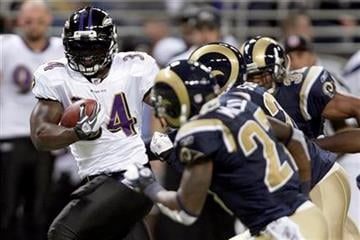 Baltimore Ravens running back Ricky Williams, left, runs for a 28-yard gain past St. Louis Rams defenders during the first quarter of an NFL football game on Sunday, Sept. 25, 2011, in St. Louis. (AP Photo/Tom Gannam) By Tom Gannam