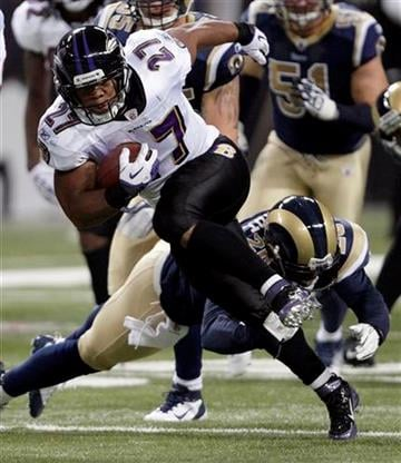 Baltimore Ravens running back Ray Rice (27) runs for a 17-yard gain as St. Louis Rams safety Darian Stewart, rear, defends during the first quarter of an NFL football game on Sunday, Sept. 25, 2011, in St. Louis. (AP Photo/Tom Gannam) By Tom Gannam
