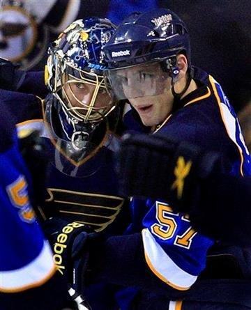 St. Louis Blues goalie Jaroslav Halak, left, of Slovakia, and teammate David Perron celebrate the Blues' 2-0 victory over the San Jose Sharks in an NHL hockey game Thursday, Nov. 4, 2010, in St. Louis. (AP Photo/Jeff Roberson) By Jeff Roberson