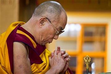 Tibetan spiritual leader the Dalai Lama prays during a prayer session in Dharmsala, India, Monday, Sept. 26, 2011. (AP Photo/Ashwini Bhatia) By Ashwini Bhatia