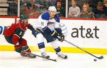 St. Louis Blues center Patrik Berglund (21) controls the puck in front of Minnesota Wild defenseman Greg Zanon during the first period of their NHL hockey game in St. Paul, Minn. Tuesday, Sept. 27, 2011.(AP Photo/Andy King) By ANDY KING