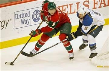 Minnesota Wild center Mikko Koivu (9) skates past  St. Louis Blues defenseman Barret Jackman during the third period of their NHL hockey game won by the Blues 4-3 in St. Paul, Minn. Tuesday, Sept. 27, 2011.(AP Photo/Andy King) By ANDY KING