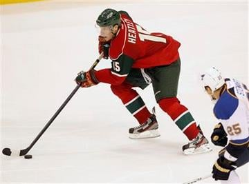 Minnesota Wild right wing Dany Heatley (15) skates past  St. Louis Blues right wing Chris Stewart during the third period of their NHL hockey game won by the Blues 4-3 in St. Paul, Minn. Tuesday, Sept. 27, 2011.(AP Photo/Andy King) By ANDY KING