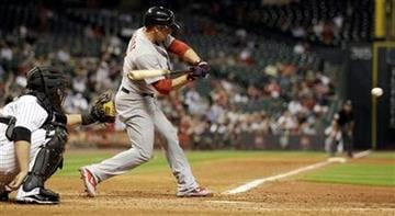 St. Louis Cardinals' Ryan Theriot (3) hits a two-run triple in front of Houston Astros catcher Humberto Quintero during the seventh inning of a baseball game Tuesday, Sept. 27, 2011, in Houston. (AP Photo/David J. Phillip) By David J. Phillip
