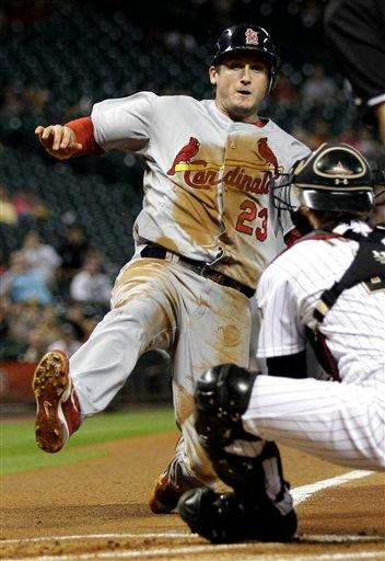 St. Louis Cardinals' David Freese (23) is tagged out at home plate by Houston Astros catcher J.R. Towles during the first inning of a baseball game Tuesday, Sept. 27, 2011, in Houston. (AP Photo/David J. Phillip) By David J. Phillip