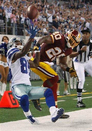 Washington Redskins free safety Oshiomogho Atogwe knocks the pass away from Dallas Cowboys wide receiver Kevin Ogletree during the second half of an NFL football game Monday, Sept. 26, 2011, in Arlington, Texas. (AP Photo/LM Otero) By LM Otero