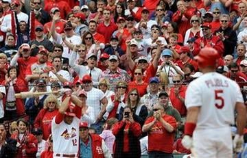 St. Louis Cardinals' Albert Pujols (5) gets a standing ovation as Lance Berkman (12) warms up in the first inning in a baseball game against the Chicago Cubs, Sunday, Sept. 25, 2011, in St. Louis. (AP Photo/Bill Boyce) By Bill Boyce