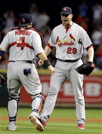 St. Louis Cardinals starting pitcher Chris Carpenter (29) and catcher Yadier Molina (4) celebrate the Cardinals' 8-0 win over the Houston Astros in a baseball game Wednesday, Sept. 28, 2011, in Houston. (AP Photo/David J. Phillip) By David J Phillip
