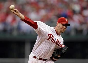 Philadelphia Phillies starter Roy Halladay  throws a pitch during the first inning in Game 1 of baseball's National League division series against the St. Louis Cardinals, Saturday, Oct. 1, 2011 in Philadelphia. (AP Photo/Matt Slocum) By Matt Slocum