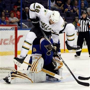 Dallas Stars' Francis Wathier (48) leaps to avoid a shot as St. Louis Blues goalie Jaroslav Halak, of Slovakia, defends during the first period of an NHL hockey game Saturday, Oct. 1, 2011, in St. Louis. (AP Photo/Jeff Roberson) By Jeff Roberson