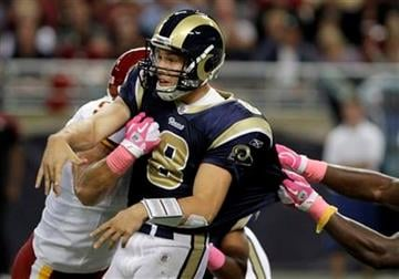 St. Louis Rams quarterback Sam Bradford is hit as he throws during the second quarter of an NFL football game against the Washington Redskins on Sunday, Oct. 2, 2011, in St. Louis. (AP Photo/Seth Perlman) By Seth Perlman