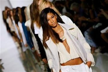 Models wear creations by rap singer Kanye West for his spring-summer 2012 ready-to-wear collection presented Saturday, Oct. 1, 2011 in Paris. (AP Photo/Francois Mori) By Francois Mori