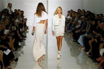 Models wear creations by rap singer Kanye West for his spring-summer 2012 ready-to-wear collection presented Saturday, Oct.1, 2011 in Paris. (AP Photo/Francois Mori) By Francois Mori