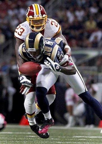 St. Louis Rams wide receiver Mike Sims-Walker (10) drops a pass as Washington Redskins cornerback DeAngelo Hall (23) defends during the first quarter of the NFL football game Sunday, Oct. 2, 2011, in St. Louis. (AP Photo/Jeff Roberson) By Jeff Roberson