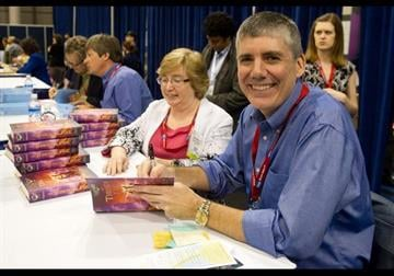 Author Rick Riordan signs copies of his books at the Book Expo America in New York, Wednesday, May 25, 2011. (AP Photo/Charles Sykes) By Charles Sykes
