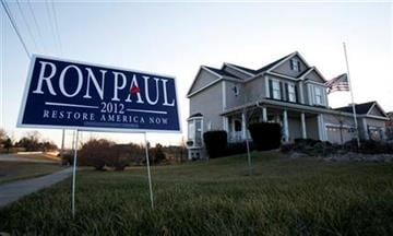 A campaign sign for Republican presidential candidate U.S. Rep. Ron Paul, R-Texas, sits in front of home, Tuesday, Dec. 27, 2011, in Ankeny, Iowa. (AP Photo/Charlie Neibergall) By Charlie Neibergall