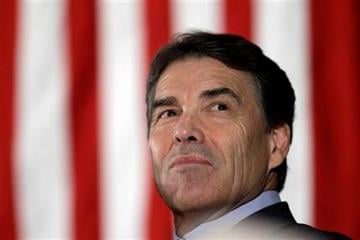 Republican presidential candidate Texas Gov. Rick Perry waits to speak at the Scott County Republican Party's Ronald Reagan Dinner, Monday, Nov. 14, 2011, in Bettendorf, Iowa. (AP Photo/Charlie Neibergall) By Charlie Neibergall