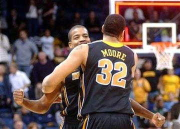 Missouri's Kim English, rear, celebrates with Steve Moore (32) after defeating Old Dominion 75-68 in an NCAA college basketball game, Friday, Dec. 30, 2011, in Norfolk, Va. (AP Photo/David B. Hollingsworth) By David B. Hollingsworth