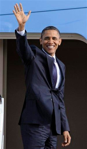 President Barack Obama waves as he boards Air Force One at Andrews Air Force Base, Md., Friday, Dec. 23, 2011. (AP Photo/Cliff Owen) By Cliff Owen