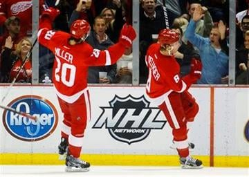 Detroit Red Wings left wing Justin Abdelkader (8) and Drew Miller (20) celebrate Abdelkader's goal in the second period of an NHL hockey game against the St. Louis Blues in Detroit, Saturday, Dec. 31, 2011. (AP Photo/Rick Osentoski) By Rick Osentoski