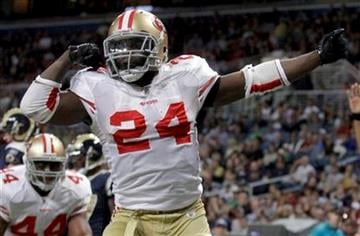 San Francisco 49ers running back Anthony Dixon celebrates after running for a 1-yard touchdown during the fourth quarter of an NFL football game Sunday, Jan. 1, 2012, in St. Louis. (AP Photo/Seth Perlman) By Seth Perlman