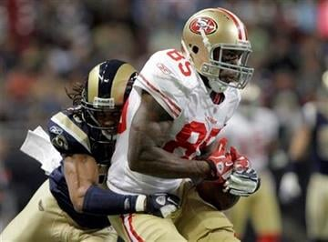 San Francisco 49ers tight end Vernon Davis, right, catches a 44-yard pass as St. Louis Rams defensive back Josh Gordy defends during the second quarter of an NFL football game Sunday, Jan. 1, 2012, in St. Louis. (AP Photo/Seth Perlman) By Seth Perlman