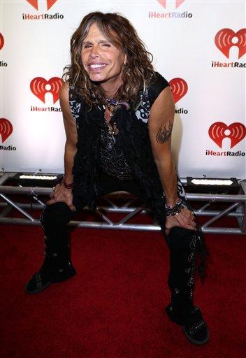 Steven Tyler arrives at the iHeartRadio music festival on Saturday, Sept. 24, 2011, in Las Vegas. (AP Photo/Jeff Bottari) By Jeff Bottari