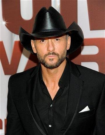 Tim McGraw arrives at the 45th Annual CMA Awards in Nashville on Wednesday, Nov. 9, 2011. (AP Photo/Evan Agostini) By Evan Agostini