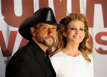 Tim McGraw and Faith Hil arrive at the 45th Annual CMA Awards in Nashville on Wednesday, Nov. 9, 2011. (AP Photo/Evan Agostini) By Evan Agostini