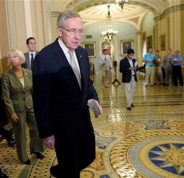 Senate Majority Leader Harry Reid of Nev., heads to the microphones to speaks to reporters during a news conference on Capitol Hill in Washington, Friday, July 29, 2011. Sen. Patty Murray, D-Wash. is at left. (AP Photo/Susan Walsh) By Susan Walsh
