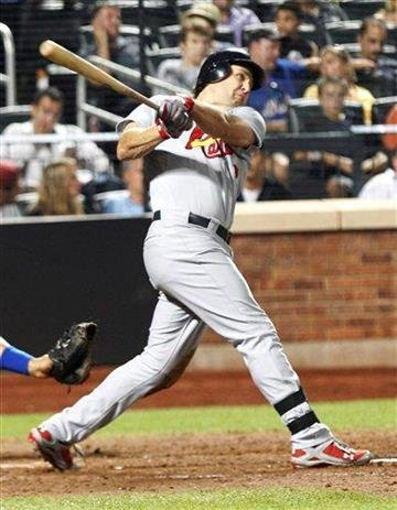 St. Louis Cardinals' Lance Berkman follows through on a home run during the seventh inning of a baseball game against the New York Mets Tuesday, July 19, 2011, at Citi Field in New York. (AP Photo/Frank Franklin II) By Frank Franklin II